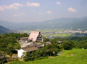 A view of Mount Yufu from an outdoor bath